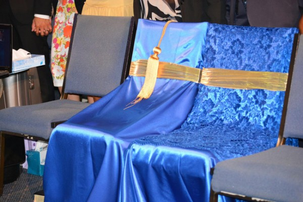 Two chairs sat empty, adorned in blue satin and gold, respectfully reserved for the late Rev. Myles Munroe and Pastor Ruth Munroe. (Photo: Troy Edward Clarke)