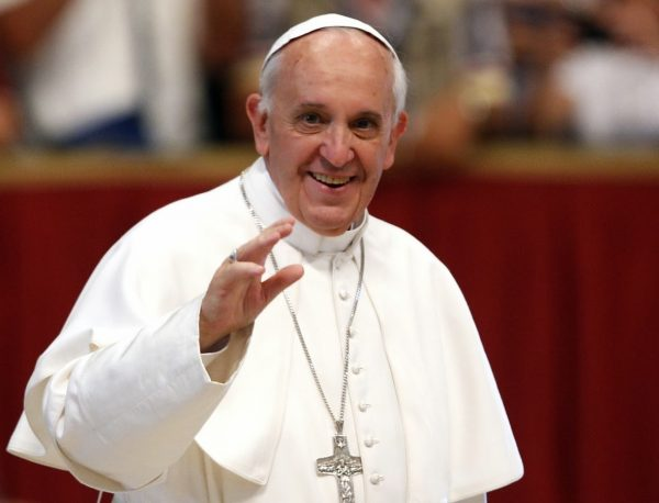 Pope Francis waves to faithful as he arrives at the end of a Mass celebrated by Brescia's Bishop Luciano Monari, not pictured, in St. Peter's Basilica at the Vatican, Saturday, June 22, 2013. (AP Photo/Riccardo De Luca)
