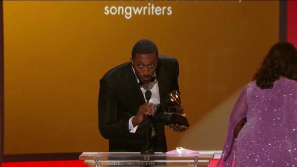 Lecrae receiving his new GRAMMY award