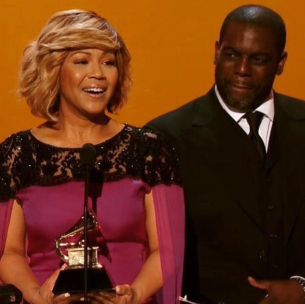 Erica Campbell receiving her GRAMMY award