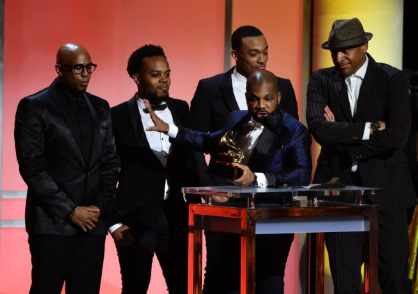 Gospel singer Kirk Franklin (C) accepts the award for the Best Gospel Performance/Song, Wanna Be Happy?, with other young Gospel singer onstage during the 58th Annual Grammy music Awards in Los Angeles February 15, 2016. AFP PHOTO/ ROBYN BECK / AFP / ROBYN BECK (Photo credit should read ROBYN BECK/AFP/Getty Images)
